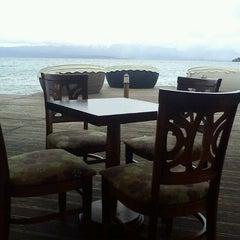 Photo taken at Kadmo Beach by Elena A. on 4/14/2012