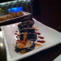 Photo taken at Sushi Axiom by Bobby H. on 4/18/2012