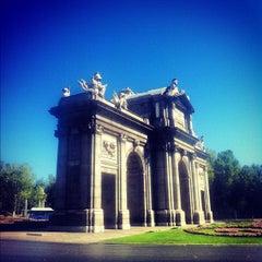 Photo taken at Puerta de Alcalá by Jorge D. on 8/28/2012