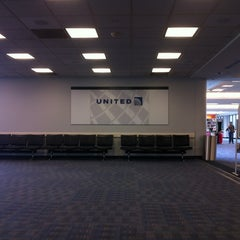 Photo taken at Gate C28 by Pee A. on 3/18/2012