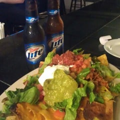 Photo taken at Wowies Sports Grill by Ashley H. on 8/13/2012