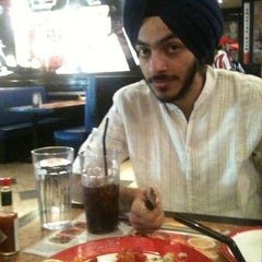 Photo taken at TGI Friday's by Paarjaat S. on 3/24/2012