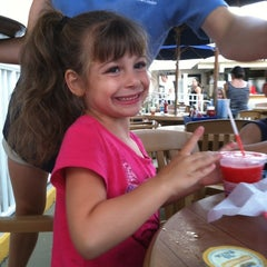 Photo taken at The Carousel Patio Bar & Grill by Americo G. on 8/10/2012