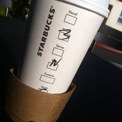 Photo taken at Starbucks by Wilfred W. on 5/16/2012