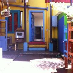 Photo taken at PataPata Hostel by Ben B. on 2/19/2012