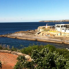Photo taken at Clovelly Beach by Adriano Souza S. on 4/24/2012