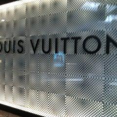 Photo taken at Louis Vuitton by Yaya E. on 9/1/2012