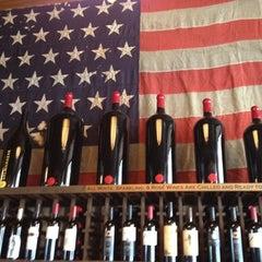 Photo taken at Bounty Hunter Wine Bar & Smokin' BBQ by Tiffany L. on 8/4/2012