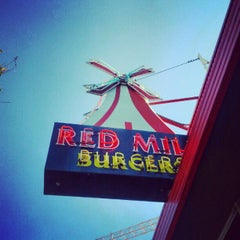 Photo taken at Red Mill Burgers by Grantland C. on 9/1/2012