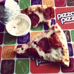 Photo taken at Pizza Pizza by Benoit L. on 6/30/2012
