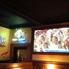 Photo taken at Panini's Bar and Grill by Pelin Kılıçkaya on 7/28/2012