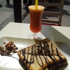 Photo taken at Cafe Downtown by Sertaç on 6/7/2012