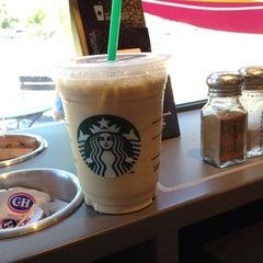 Photo taken at Starbucks by Manuel L. on 7/10/2012