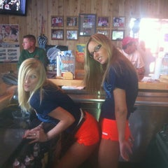 Photo taken at Hooters by Courtney V. on 5/9/2012