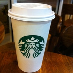 Photo taken at Starbucks by Marcos G. on 3/2/2012