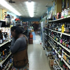 Photo taken at Downtown Wine & Spirits by Tommy M. on 6/14/2012