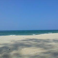 Photo taken at Pantai Batu Buruk by Noor Amalia S. on 7/28/2012