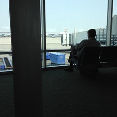 Photo taken at Gate A51 by Elisabeth S. on 8/15/2012