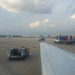 Photo taken at Gate T12 by Ronald S. on 8/8/2012