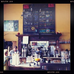 Photo taken at Claire de Lune Coffee Lounge by Brent A. on 8/12/2012