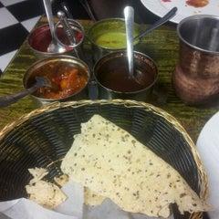 Photo taken at Taste Of India by Melanie W. on 6/1/2012