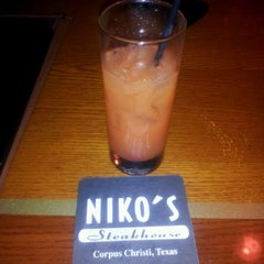 Photo taken at Niko's Steakhouse by Rossalyn H. on 4/21/2012