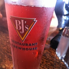 Photo taken at BJ's Restaurant and Brewhouse by Ashley B. on 6/15/2012
