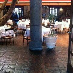 Photo taken at El Caserío Restaurante Bar by Eduardo P. on 7/30/2012