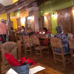 Photo taken at Raices Restaurant by Miguel H. on 8/12/2012