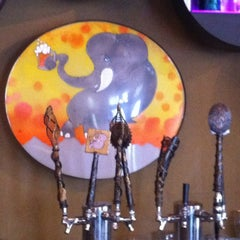 Photo taken at Thai Me Up Restaurant and Brewery by Lela G. on 5/19/2012