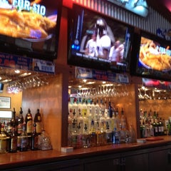Photo taken at Boston's Restaurant & Sports Bar by Dani G. on 5/21/2012