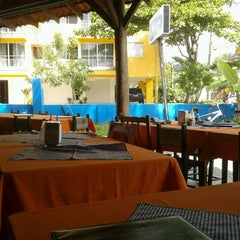 Photo taken at Restaurante Quinha by Henrique S. on 4/15/2012