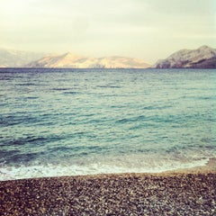 Photo taken at Baška Beach by Marie R. on 6/23/2012