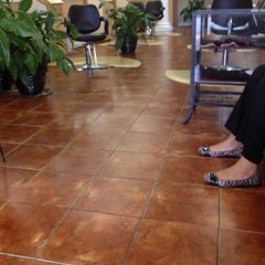 Photo taken at The Perfect Weave Salon by Oreo M. on 3/2/2012