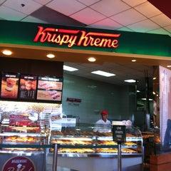 Photo taken at Krispy Kreme by Adrian M. on 5/26/2012