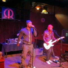 Photo taken at Jimmyz Gastropub & Red Room Lounge by Eric K. on 3/21/2012