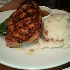 Photo taken at Outback Steakhouse by Vanessa D. on 6/8/2012