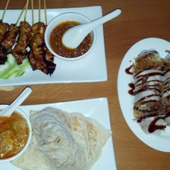 Photo taken at Peninsula Malaysian Cuisine by Erin O. on 9/3/2012