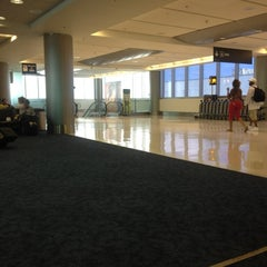 Photo taken at Gate D60 by Stephen M. on 9/2/2012