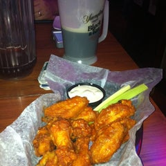 Photo taken at GridIron Sports Bar & Pizzeria by Ellen M. on 4/4/2012