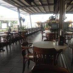 Photo taken at DÔME Café by Shafiq S. on 3/5/2012