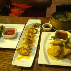 Photo taken at Wild Ginger Pan-Asian Vegan Cafe by Stephanie D. on 8/13/2012