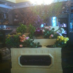Photo taken at Flora & Muse by Joseph E. on 5/19/2012