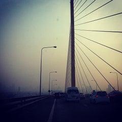 Photo taken at สะพานพระราม 9 (Rama IX Bridge) by Toon T. on 4/3/2012