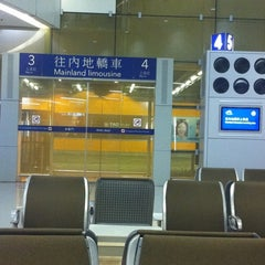 Photo taken at Passenger Terminal Building / Cheong Tat Road Bus Stop 機場客運大樓/暢達路巴士站 by Masanori N. on 8/2/2012