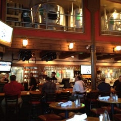 Photo taken at Rock Bottom Brewery by Jason E. on 7/26/2012