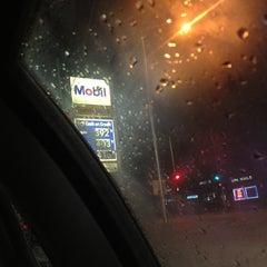 Photo taken at Mobil by Kuran M. on 4/20/2012