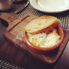 Photo taken at Michael's Genuine Food & Drink by Nadim J. on 3/4/2012