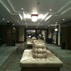Photo taken at Kensington Close Hotel by Adeline W. on 7/9/2012