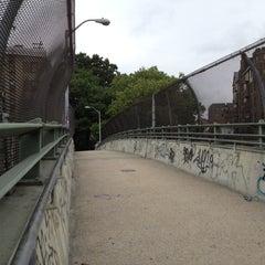 Photo taken at East 8th Street Footbridge by Justin W. on 6/19/2012
